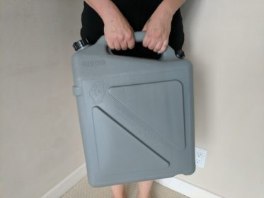 How easy is it to carry an emergency water container