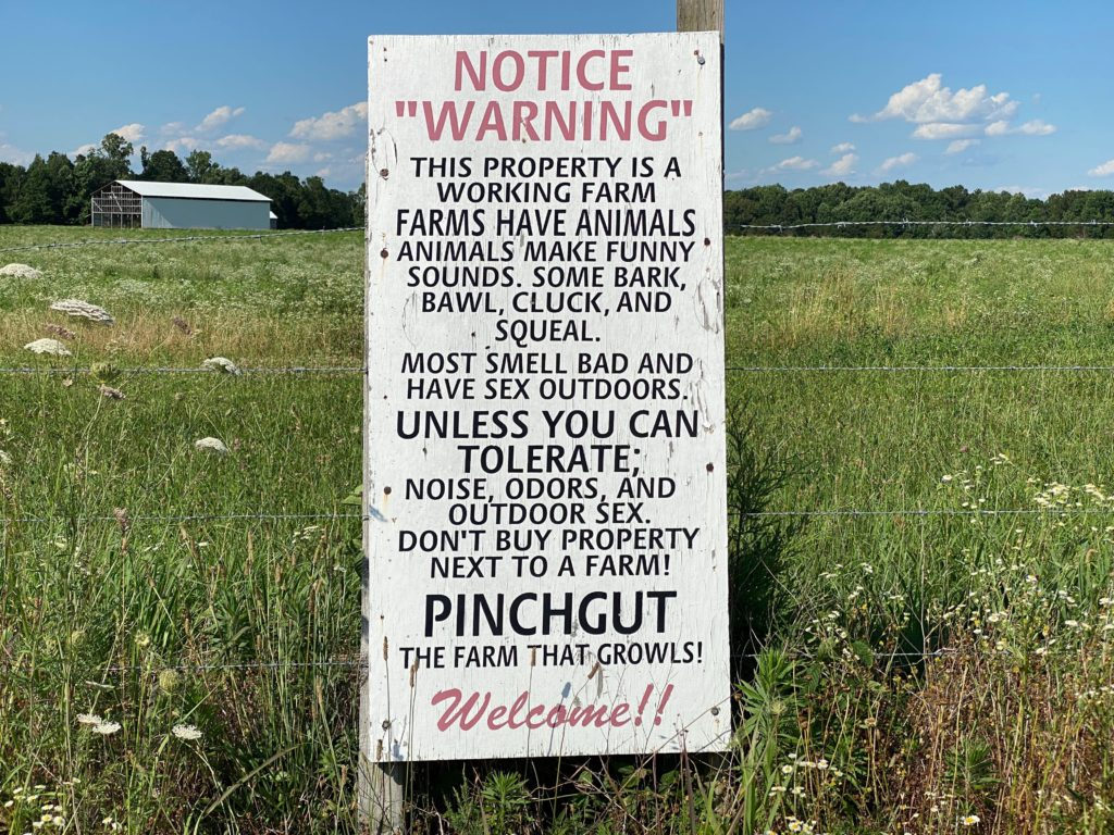 A funny farm warning sign