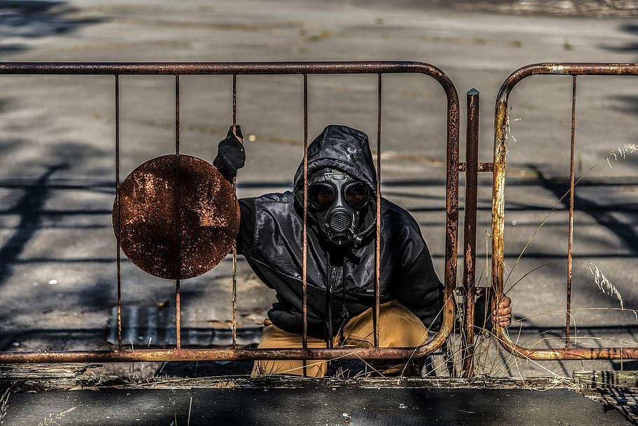 Stalker emerges from a manhole around Chernobyl