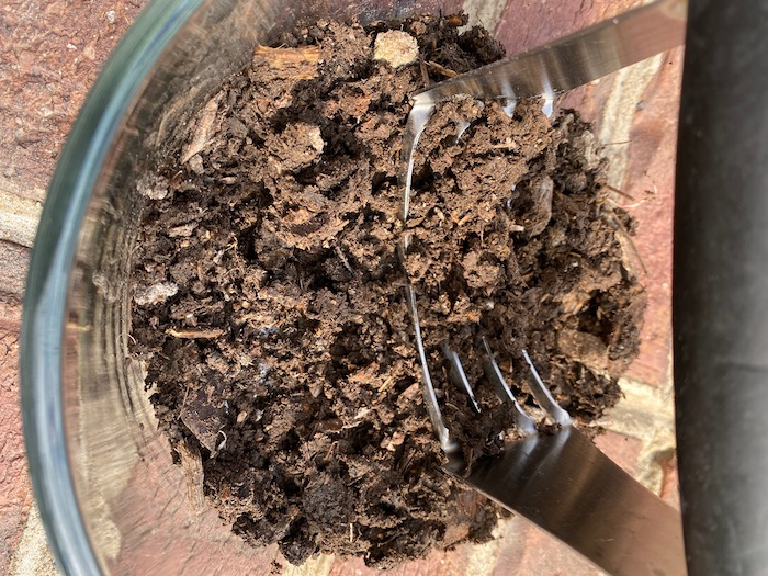 Chopping soil with a pastry cutter