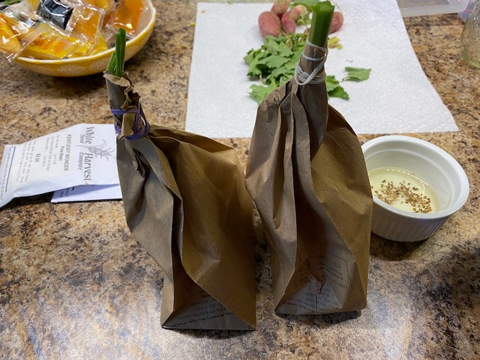 Harvesting seeds in a paper bag
