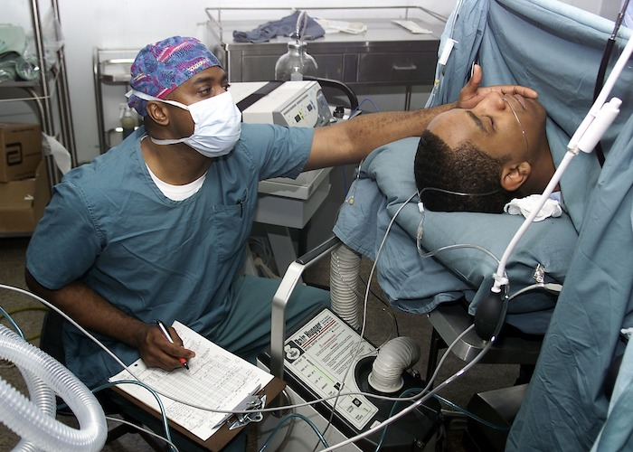 Doctor checking a patient in a bed